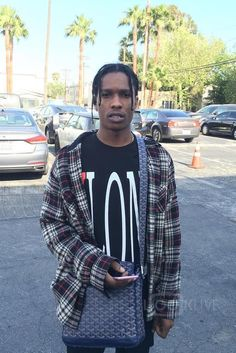 ASAP Rocky wearing  V Lone Vlone T-Shirt, Goyard MM Shoulder Bag