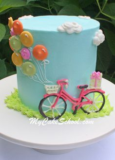 Adorable and simple Bicycle with Balloons Cake Tutorial by MyCakeSchool.com! Online cake tutorials, recipes, videos, and more!