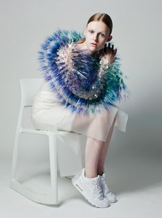 Hundreds of colourful bristles emanate from headdresses in Maiko Takeda's millinery collection, presented at the Royal College of Art fashion show earlier this week.