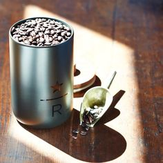 A+ceramic+coffee+canister+with+wooden+lid+and+Starbucks+Reserve<sup>®</sup>+logo.