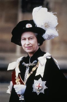 The black velvet Tudor-style bonnet is stitched with white ostrich feathers and black heron feathers and — just in case anyone forgot — is also Queen Mary, Queen Elizabeth Ii, Princess Of Wales, Princess Diana, British Crown Jewels, Order Of The Garter, Royal Uk, Hooded Cloak, Isabel Ii