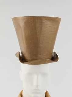 Hat  John N. Genin     Date:      ca. 1855  Culture:      American  Medium:      a) linen, silk, leather, paper; b,c) leather; d-f) paper  Dimensions:      Diameter (a): 8 in. (20.3 cm) Height (a): 8 3/4 in. (22.2 cm) Length (b,c): 13 7/8 in. (35.2 cm) Height (d): 10 in. (25.4 cm) Length (e): 14 1/2 in. (36.8 cm) Length (f): 6 1/2 in. (16.5 cm)  Credit Line:      Purchase, Judith and Ira Sommer Gift, 2006  Accession Number:      2006.30a–f