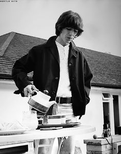 George Harrison pours himself a cup of tea in the backyard of his home, Kinfauns.