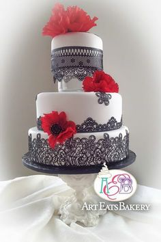 Art Eats Bakery 1626 East North Street, Greenville, SC 29607https://www.facebook.com/ArtEatsBakerySCBlack edible romantic edible black lace modern wedding cake with bold red poppy flowersThe best custom designed unique #creative #modern birthday, baby shower and elegant romantic wedding cakes create a personal element to your party or reception that cannot be matched by decor or venue. It is the first thing your guests see at the party or reception and the las...