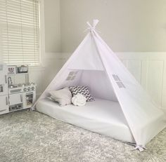 ***As seen in Mother & Baby and Today's Parent Magazine*** Gorgeous, handmade play tents - Entrepreneur Magazine  Meet the newest Domestic Objects product!  Its a play tent shaped bed canopy that fits over top of your mattress on the floor (you choose the size). This is perfect for you toddler