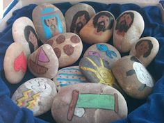 Story Stones to help tell stories and then let children re-enact what they have heard.  Fantastic!