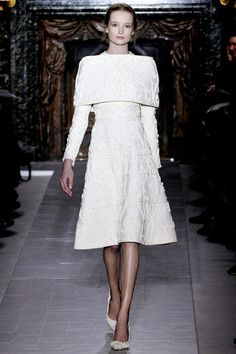 8.Cote-Hardie Valentino Couture Spring Collection 2013 A variant of a surcote or outer tunic. The Valentino take is identifiable to the dramatic  shoulder fold of the original garment.