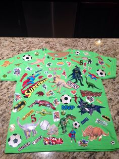 Nico's 100 days of school shirt (pre-k4). 100 stickers of his favorite things!