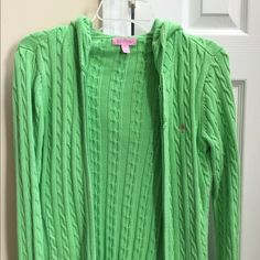 Lily Pulitzer green cardigan sweater sz medium Green cardigan zip up sweater. It says size medium but I think it is more like a small.  EUC     Smoke free home. Adorable color and style. Lilly Pulitzer Sweaters Cardigans