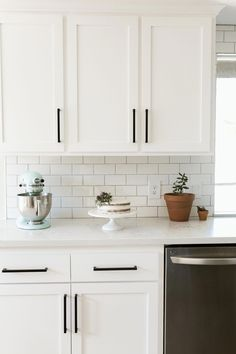 Kitchen Renovation #shakercabinets #subwaytile #shakercabinet #whitekitchen #updatedkitchen #blackkitchenhardware #modernhardware #blackhardware #modernfarmhouse #modernfarmhousekitchen #farmhousekitchen #kitchenremodel #KitchenCountertopsWood