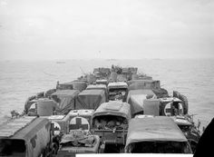 Vehicles of 168 Field Ambulance RAMC, attached to 8th Armoured Brigade, aboard USS LST-25 off GOLD assault area, 6th June