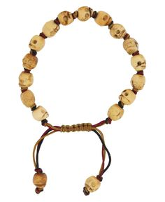 In Tibetan Buddhism, skulls are used to signify impermanence and encourage a life of compassion. This wrist meditation mala features 15 individually knotted skull beads for counting and repeating mantras and prayers.