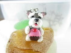The Schnauzer looks like my old dog dexter and the cupcake would represent my other old dog cupcake :)))) I want it so bad!!!!!