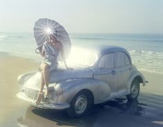 Audrey Marnay for Japanese Vogue on a silver Morris Minor in Goa, India 2007 photographed by Tim Walker