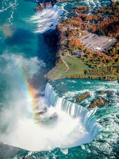 INCREDIBLE AERIAL VIEW OF HUGE WATERFALLS AND RESULTING RAINBOW!