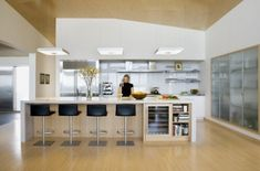 bar stools at one end, wine cooler and bookshelves at the other - could add those in someday