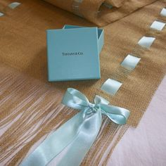 Burlap and Tiffany Blue Ribbon Runner. $40.00, via Etsy.... maybe I could do this with pink