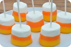 Candy corn dipped marshmallow pops