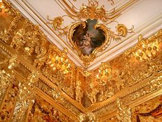 "A detail in the Amber Room of the Catherine Palace, St. Petersburg, Russia.  The Amber room was ""lost"" during WWII and was reconstructed in 2003 to celebrate the 300th Anniversary of St. Petersburg."