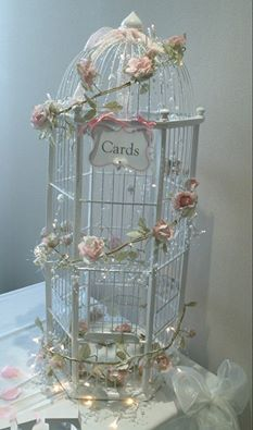 Beautiful and unusual birdcage post box, adorned with vintage style roses and lights. Available to hire from makeitspecialevents.co.uk