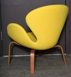 Early Swan Chair with Wooden Legs by Arne Jacobsen | From a unique collection of antique and modern lounge chairs at https://www.1stdibs.com/furniture/seating/lounge-chairs/