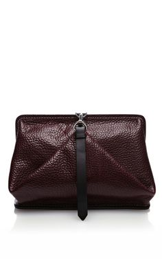 This geometric Alexander Wang clutch features contrast stitching, tonal painted edges, a tonal belt-style strap at the front and four protective metal feet.Lined interior features one exposed zip pocket with designer stamped tagExposed zip closure with lobster claw fastening100% bovineImportedPlease note: This item is returnable for credit or full refund.