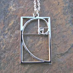 This silver Fibonacci necklace would look fabulous with a bright purple sweater and some great looking jeans.