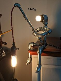 Pipe lamp – Eclectic Home Decor Today Lampe Edison, Lampe Steampunk, Desk Lamp, Lamp Table, Alcohol Dispenser, Industrial Pipe, Vintage Industrial, Industrial Style, Driftwood Lamp