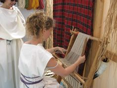 miniature warp-weighted loom at a Gallo-Roman festival in Castelculier, 2011