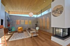 concrete wall living room  | Contemporary living room with concrete walls wood flooring and high ...