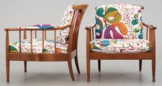 Pair of Kerstin Hörlin Holmquist mahogany arm chairs...not sure if the fabric us original or indeed who the designer is but the chairs and fabric are perfect together