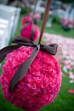 love the mix of deep pink with chocolate satin ribbon - the flowers are carnations