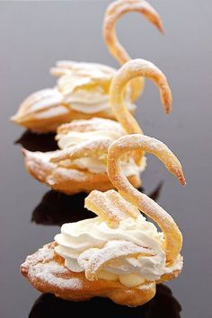 Puff Swans Cream Puff Swans - forgot all about these! Made them in pastry school.Cream Puff Swans - forgot all about these! Made them in pastry school. Desserts Français, Beaux Desserts, French Desserts, Delicious Desserts, Dessert Recipes, Yummy Food, Paris Desserts, Unique Desserts, Plated Desserts