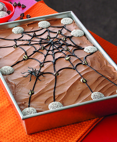 """This chocolate and orange old-fashioned """"Poke"""" Cake is easy to decorate and perfect for Halloween."""