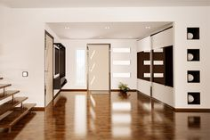Hallway sliding wardrobe doors. 3 panel wide band door with black glass in the middle and white glass top and bottom.