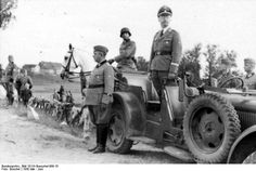 JUN 23 1942 A proposal to sterilize 2-3 million Jews 'Soviet Union, North – Reichsführer-SS Heinrich Himmler standing in a car during a parade of a mounted military band of the SS Cavalry Division.'