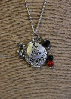 Diffuser Necklace with Silver Locket and Chain decorated with Czech Bead, Coral Bead, Fleur Di Lis andFollow Your Dream Charms