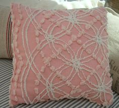 I bought a vintage chenille bedspread that looks similar to this at a festival.  Absolutely beautiful!