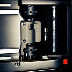 Sprocket - Up close to the Nikon film loading mechanism. Nikon has autoloading system initiated by closing the back door and press the shutter button. IT has unique film guide in place. Nikon, Back Doors, Shutters, Espresso Machine, My Photos, Coffee Maker, Button, Film, Unique