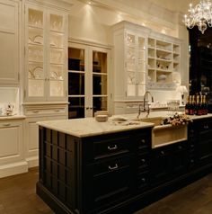 Stunning creamy colored cabinets with black island, and sumptuous white marble..Cottonwood