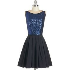 Admiring your glowing reflection in the mirror, you feel positively regal in this dazzling dress! Twinkling navy-blue sequins festoon the front of this black A…