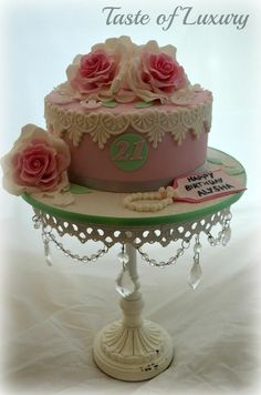 Pink cake with white lace and pink roses