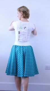 Polka dots full circle skirt, skater skirt for women made in 1950S style is made in turquoise polka dots design. The skirt is made in knee length and with elastic waistband for easy fit.
