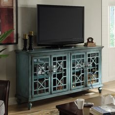 Mendenhall 4  Door Teal Media  and Credenza. Love to see the T.V. actually have a home where it looks happy!
