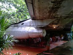 Abandoned Airplane Converted into a Cafe    This is Café May Bay, located at 10°48'36.72''N 106°40'11.29''E - near Tan Son Nhut airport, in Ho Chi Minh city (Saigon), Vietnam: image  by Aurelien-Jouve)