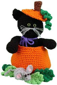 "Design By: Maggie Weldon Skill Level: Easy Size: Cat is approx 14"" high Materials: Worsted Weight Yarn: 9 oz, 495 yds Orange (O); 12 oz, 660 yds Black (BL); ¾ oz, 41 yds Dark Green (DG); ½ oz, 26 yds"