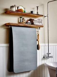 Make room for inner calm. Try using a kitchen rail mounted to the underside of a shelf to dry out hot yoga mats and store meditation material on top. Kitchen Tiles Design, Kitchen Wall Tiles, Workout Room Home, Workout Rooms, Kitchen Rails, Best Home Interior Design, Bathroom Hacks, Ikea Home, Home And Deco