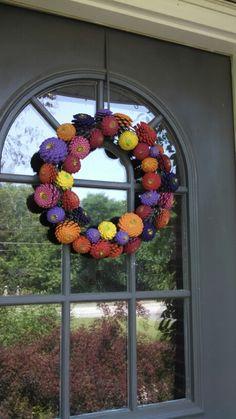 Painted pinecone wreath. Looks like zinnias.