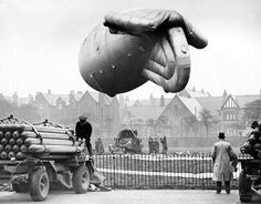 A barrage balloon site in Liverpool. Balloon Command grew from 624 balloons in 1939 to 1466 in service. 450 balloons were used to defend London alone. The balloons were set at 5,000 feet, forcing the enemy to climb, affecting their bombing accuracy and putting them in range of the anti-aircraft guns. Searchlights stationed at the gun batteries had the same effect.