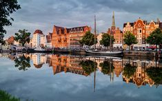 Download wallpapers Lubeck, evening, sunset, canal, sailboats, Germany